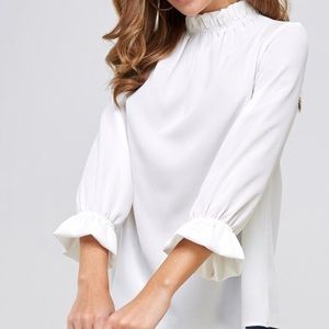 Off white ruffle top blouse. New with tags!
